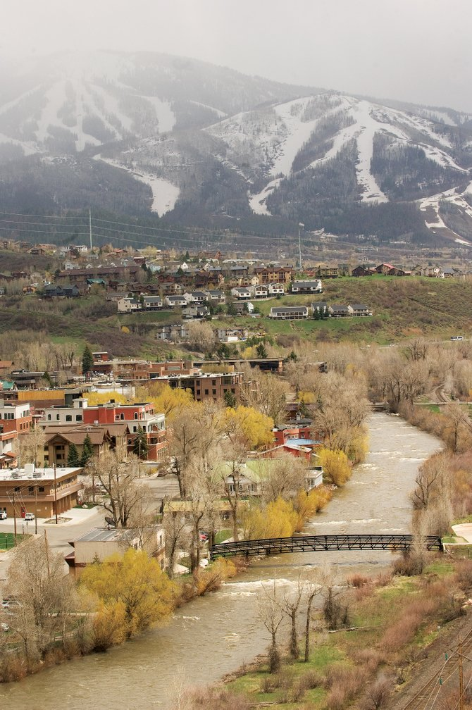 The Yampa River flows through downtown Steamboat Springs on Monday afternoon. Recent precipitation has boosted area streamflows, but emergency management officials still say the chance for flooding remains low.