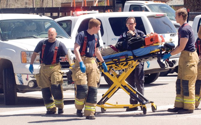 Steamboat Springs Fire Rescue members moved an unidentified man from the intersection of U.S.40 and Pine Grove Road on Wednesday afternoon. The man was struck by a pickup truck while crossing the road, transported to the Yampa Valley Medical Center and then flown to Denver on Wednesday afternoon with significant head injuries.