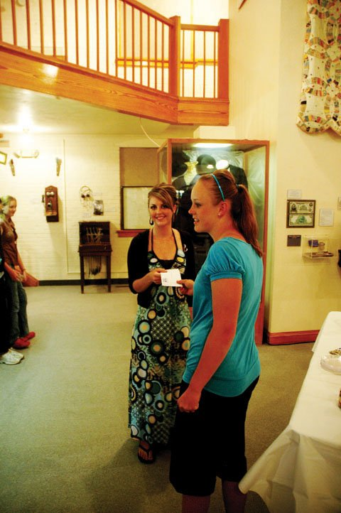 Summer Hudish, left, receives a check from MCHS senior Dani Kawcak, during a presentation Wednesday at the Museum of Northwest Colorado. Kawcak, along with three other members of the MCHS Key Club, presented the checks to four local agencies.