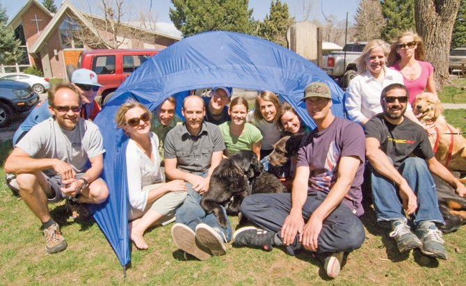 The employees at Big Agnes sit in a tent in front of their downtown Steamboat Springs office. The company was named one of 50 Colorado Companies to Watch by the Edward Lowe Foundation.