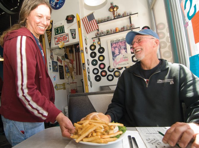 Kimberley Mares serves Ken Kruse inside Johnny B. Good's Diner in Steamboat Springs last week. The diner, along with several other downtown restaurants and businesses, will take part in Mainstreet Restaurant Week from May 18 to 25.