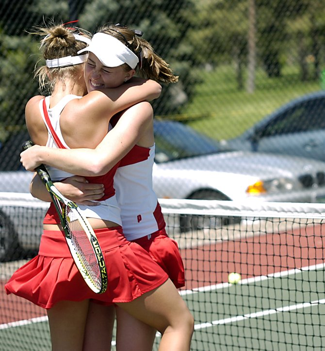 Sara Bearss, left, and Kylee Swiggart hug after winning the Class 4A No. 1 doubles state championship on Saturday in Pueblo.