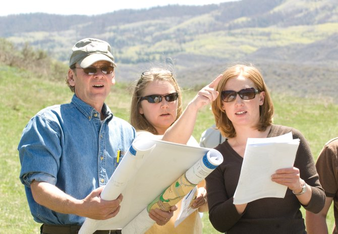 Steamboat 700 consultant Peter Patten, from left, goes over the planned development with planning commission members Karen Dixon and Sarah Fox on Monday while touring the site in west Steamboat Springs. On Thursday, the Steamboat Springs Planning Commission will provide feedback to developers about the annexation proposal.