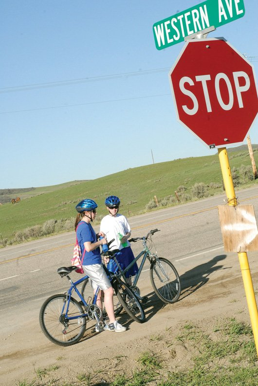 "Becky, left, and Kaci Meek, of Craig, take a break during last year's ""Where the Hell's Maybell?"" bike ride. The ride, which is in its 23rd year, takes off at 7 a.m. Saturday from Northwest Storage and 7:30 a.m. from Western Knolls. It ends in Maybell."