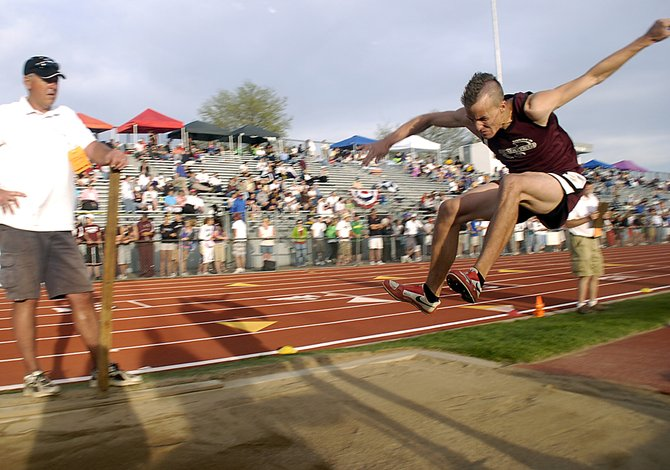 Soroco High School junior Alex Estes leaps to a second place finish Thursday at the state track meet in Lakewood. Estes saved his best jump for last, hurdling from sixth place to second place with one jump.