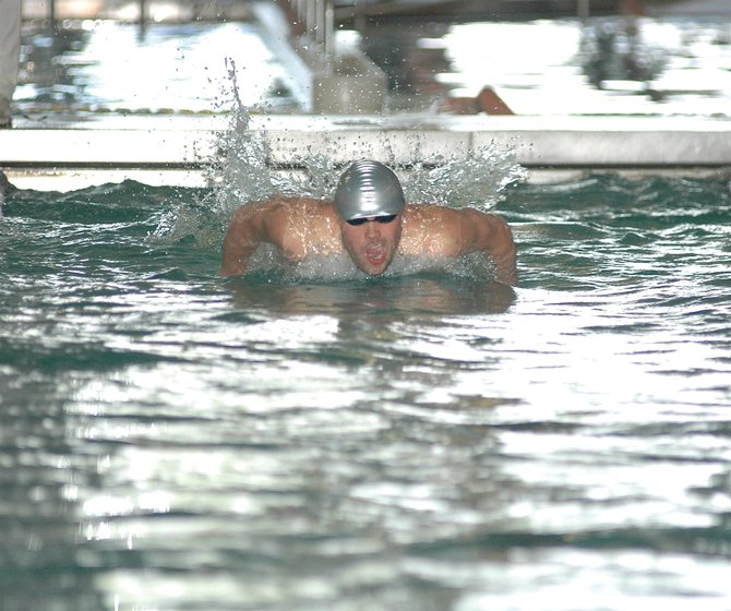 Cole Worsley swims the 100-yard butterfly Friday during the opening day of the Class 4A State Swimming Championships in Loveland. Worsley qualified with second place for today's finals in the 100 butterfly and first place in the 50 freestyle. His time of 21.05 in the 50 free set a new Class 4A state record.