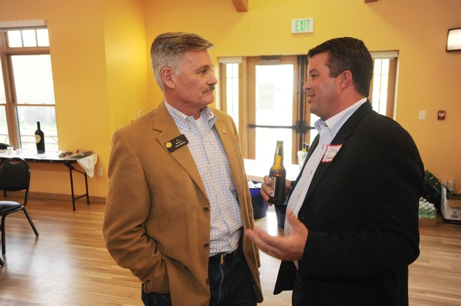 Steamboat Springs resident Chris Kaminski, right, visits with state Sen. Al White, R-Hayden, on Friday during the Routt County Republican Central Committee's annual Lincoln Day Dinner at the community center.