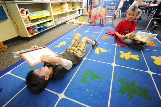 Soda Creek Elementary School kindergartners Jack Cashen, left, and Toby Morse read Friday in Sharon Clementson's classroom. Local school districts are preparing for an increase in the number of kindergartners next school year.