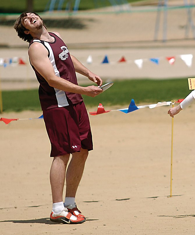 Soroco High School junior Matt Watwood reacts after finding out his final throw in the discus was just five inches short of first place Friday at the state track meet in Lakewood. Watwood said he was pleased to place second.