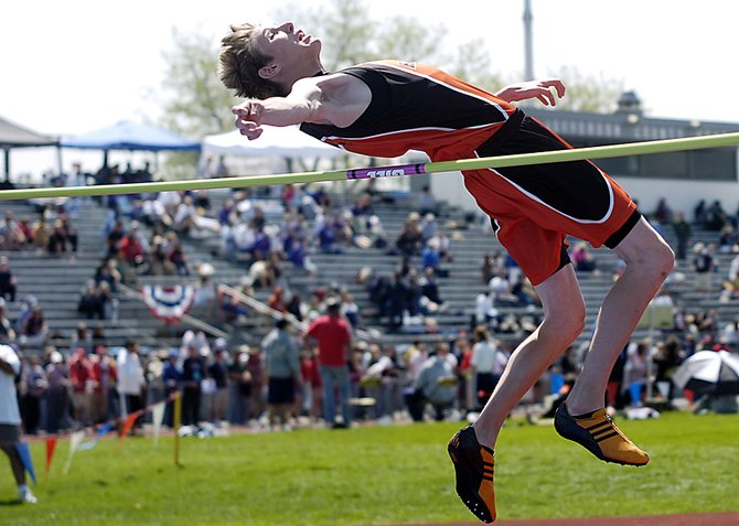Murphy Smartt soars over the bar during Saturday's high jump competition at the state track meet in Lakewood. Smartt, a Hayden High School junior, placed second in the event.