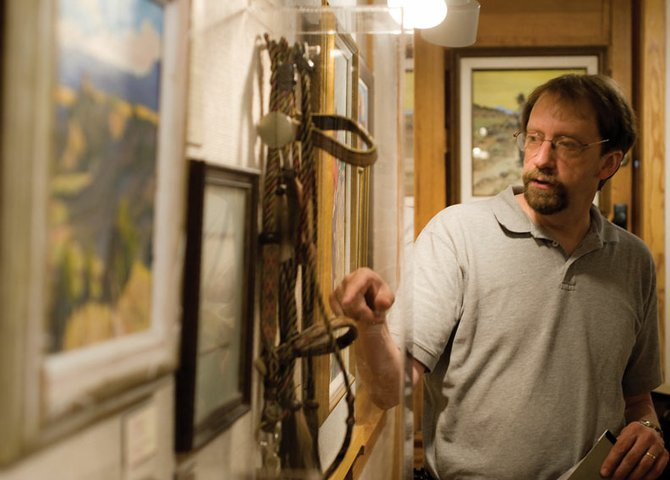 "Dan Davidson, Museum of Northwest Colorado director, talks about a horsehair headstall Wednesday that was created in the Wyoming State Penitentiary in Rawlins, Wyo. The item is part of a new museum exhibit titled ""Passing of the Old West,"" which premiers Sunday."