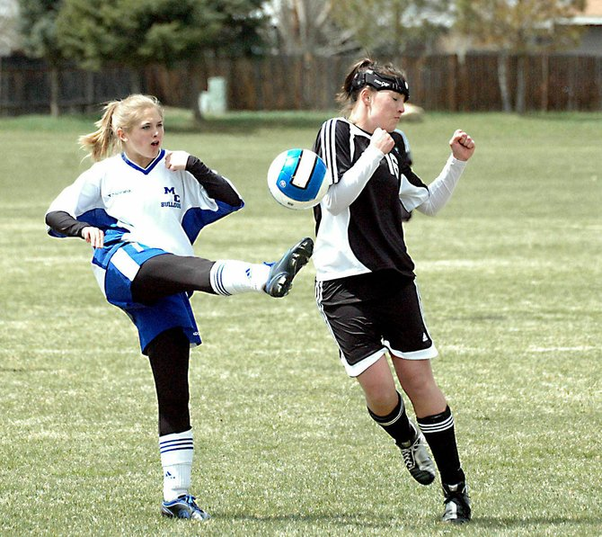 Amanda Brewer, left, kicks the ball against Eagle Valley. Nicole Dolence, Moffat County High School girls soccer coach, said Brewer was one of her most valuable players on offense this season.