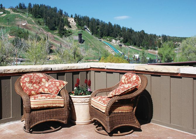 Decks on the south side of The Olympian overlook the Yampa River and the ski jumps at Howelsen Hill. Two units have sold at the luxury condominium building.
