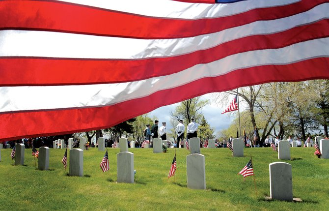 A crowd gathered during last year's Memorial Day service at Craig Cemetery. This year's service, hosted by the Veterans of Foreign Wars Post 4265, American Legion Post 62 and the Sons of the American Legion, begins at 11 a.m. Monday. It is open to anyone wishing to pay their respects to veterans.