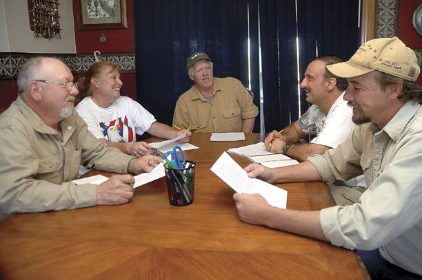 "At the dining room table of Bill and Dona Shue, at left, the Tea Party Patriots of Northwest Colorado meet together for the second time. The other three are, from left, Rob Schmitzer, Patrick Germond and Rick Barnes. The group plans to host a public meeting June 5 at a location to be determined. Dona said she plans to start a Web site for the group at <a href=""http://www.nwcoloteapartypatriots.org"">www.nwcoloteapartypatriots.org</a>."