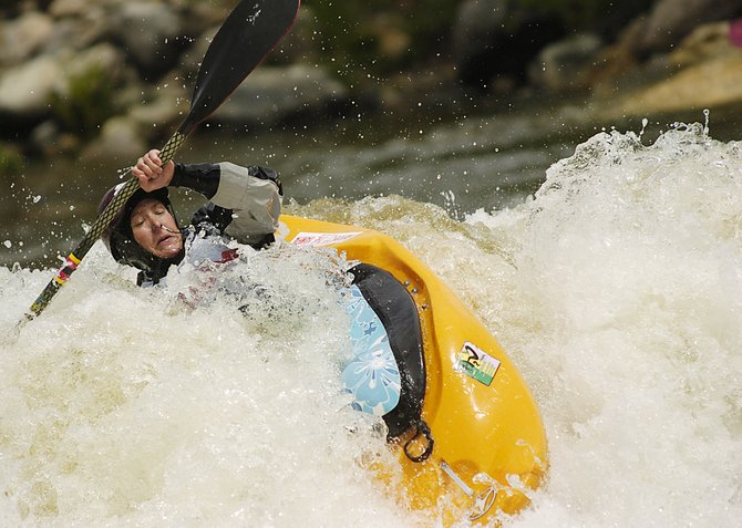 Sarah Hamilton tries to work through a wave Saturday at Charlie's Hole in downtown Steamboat Springs. Hamilton, the only woman competing in the kayak rodeo at the Yampa River Festival, placed third in the event.