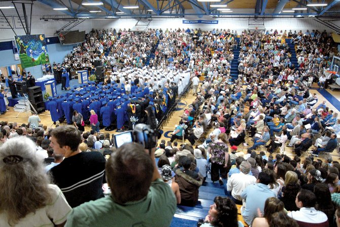 The Moffat County High School graduating class of 2009 stands Saturday during the ceremony.