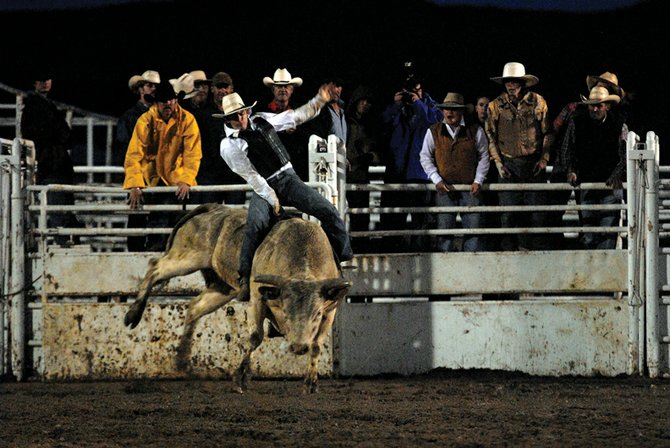 A competitor fights for his eight seconds Saturday during the Lane Frost Challenge bull riding competition. The competition featured a few local riders, including two former Moffat County High School students who graduated that afternoon.