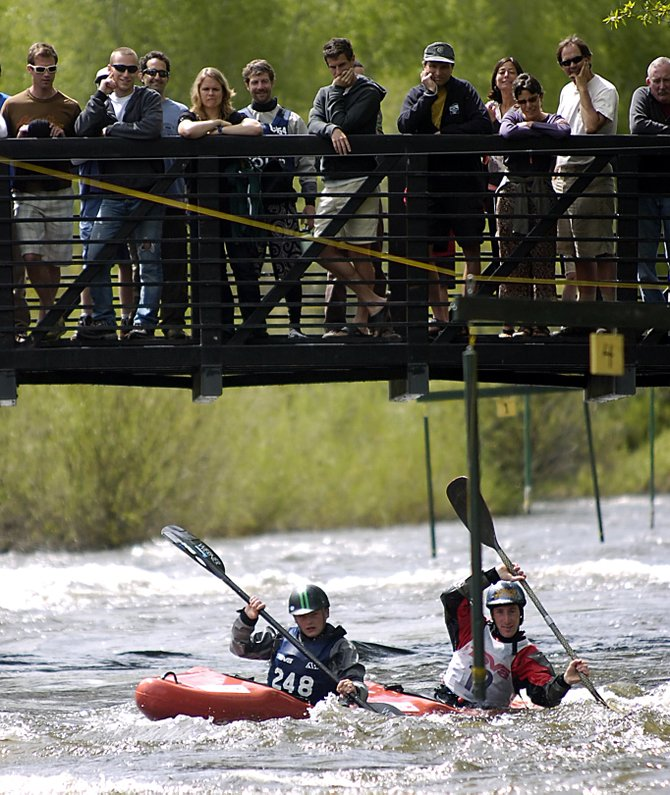 Karsten Thompson, left, and Marty Smith tries to make it through a gate Sunday at the kayak slalom during the Yampa River Festival.