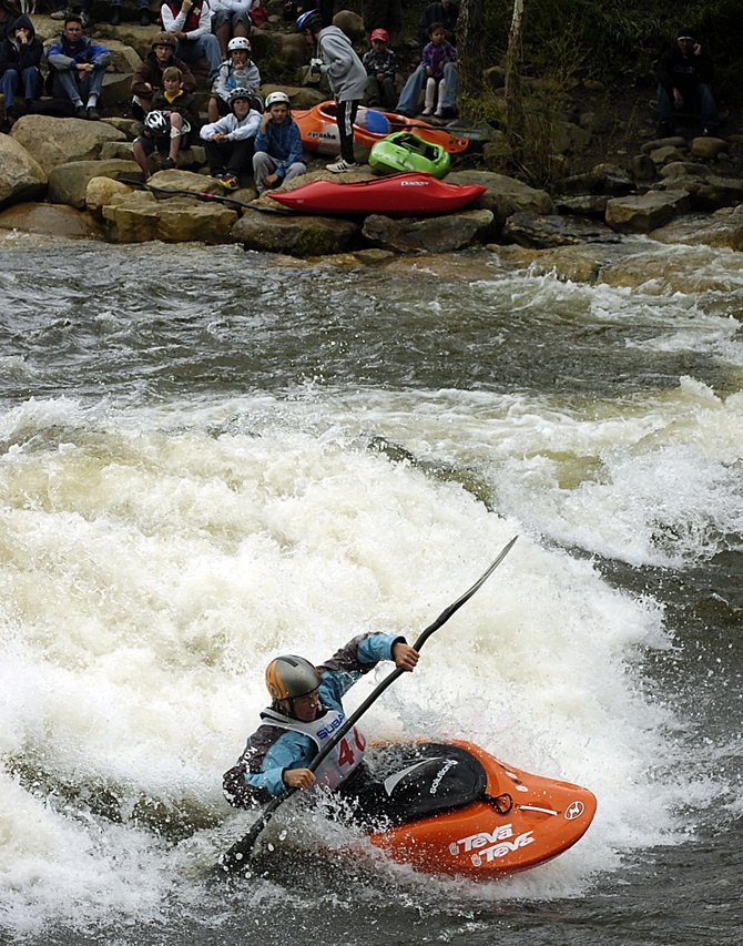 Tanya Faux fights through the Yampa River on Monday during the Paddling Life Pro Invitational at Charlie's Hole in downtown Steamboat Springs. Faux won the event again, finishing first in the freestyle event and the Fish Creek race.