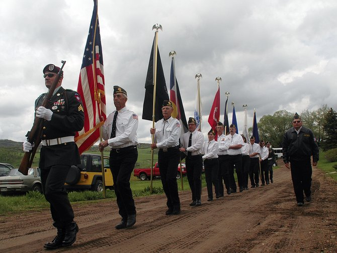 Veterans of Foreign Wars Post No. 4264 commander Tony Weiss, left, leads the color guard at Monday's Memorial Day service in Steamboat Springs.