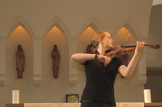 Violinist Anna Roder runs through her program during a rehearsal at St. Paul's Episcopal Church on Tuesday afternoon.