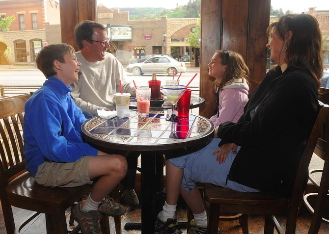 Zabel family members, from left, Taylor, 12, Glen, Bailey, 10, and Connie share a laugh after dinner Tuesday at Cantina Mexican Restaurant. The restaurant's owner, Kristi Brown, said business was up last week, which was the inaugural Steamboat Springs Restaurant Week, compared to the year before.