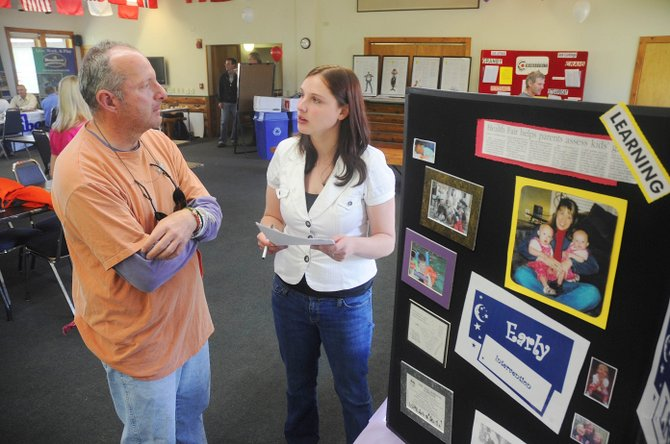 Steamboat Springs resident David Watkins talks to Amanda Shipps with Horizons Specialized Services on Thursday about job openings during the Colorado Workforce Center's resource fair held at Olympian Hall.