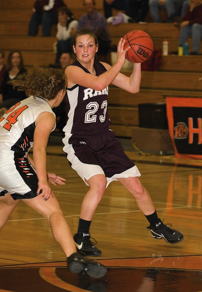 Soroco High School senior Sarajane Rossi, shown here looking for a pass in December 2008 against Hayden High School, intends to walk on to the basketball program at Mesa State in Grand Junction in the fall.