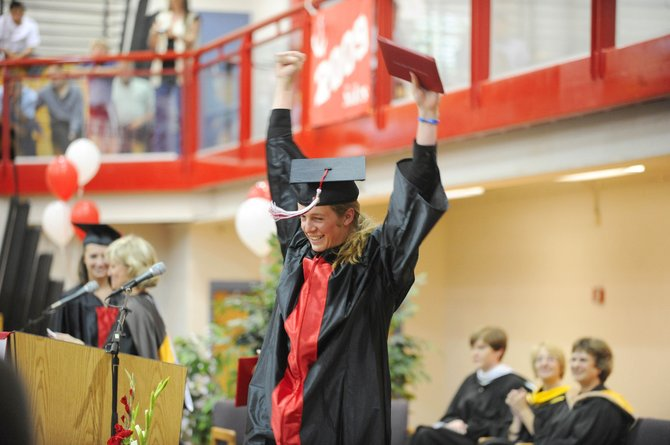 Steamboat Springs High School graduate Parker Stegmaier raises his arms in celebration after receiving his diploma Saturday in Kelly Meek Gymnasium.