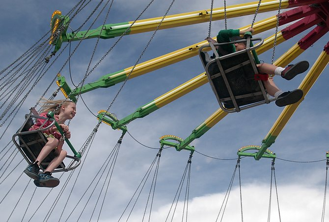 Svea Andrews, 9, rides the Yo Yo ride at the carnival in the Meadows parking lot in Steamboat Springs on Sunday.