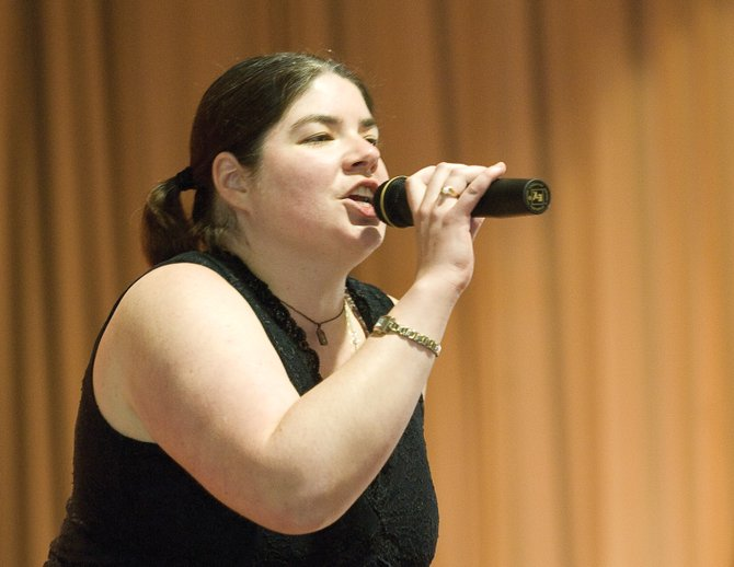 Strawberry Park Elementary School music teacher Michelle Hess sings a song during the annual talent show Wednesday afternoon. Hess will be giving a farewell concert at 7 p.m. today at Holy Name Catholic Church.