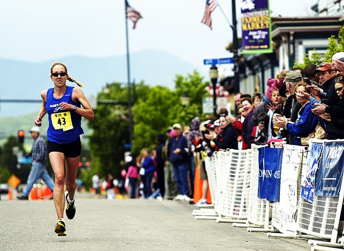 Noelle Green flies toward the finish line during Sunday's Steamboat Marathon. Green easily won the women's race, finishing more than 20 minutes before any other woman.