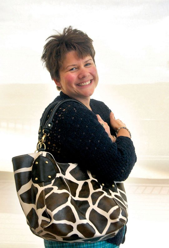 Sandra King, of Craig, shows off her giraffe bag she bought at a Moxie Soul apparel event. It's currently her favorite bag and an example of a simple, fun and functional purse.