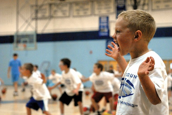 Ryan Peck, 5, yells out during the Moffat County Bulldog summer basketball camp Wednesday. Peck is one of 68 kindergarten through eighth-grade students learning fundamentals at the three-day camp.