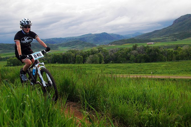Women's novice rider Kassi Sell cuts around a curve Wednesday during the first Town Challenge mountain bike race of the season. The event, at Marabou west of Steamboat Springs, drew nearly 175 riders.