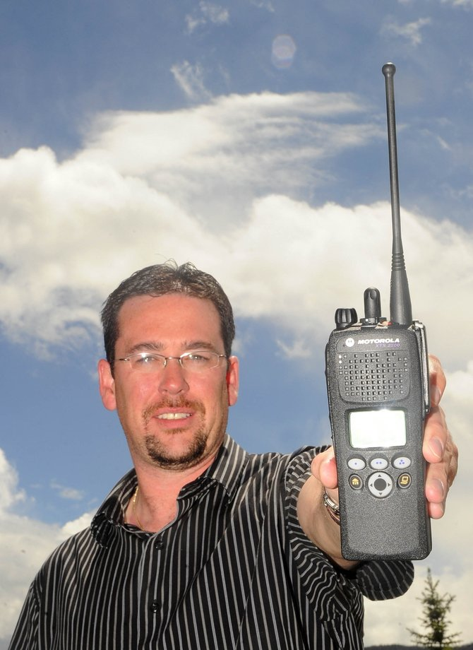 Routt County Communications Director J.P. Harris displays one of the 800 megahertz radios now being used by all emergency responders in Routt County.