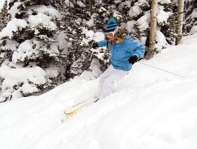 Skier Jenny Mustard rips through fresh snow at Steamboat Ski Area in April. The Colorado Ski Country USA trade association announced Thursday that skier visits to Colorado resorts fell 5.5 percent, to 11.85 million, last season.