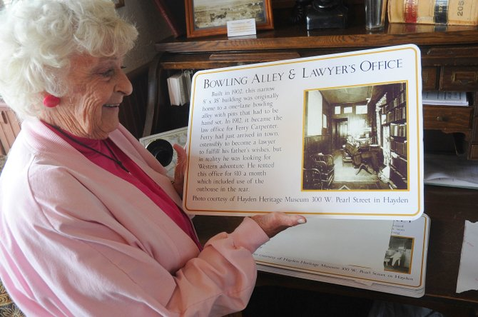 Hayden resident Donna Hellyer talks about one of the informational plaques that will be placed on a building in historic downtown Hayden. This plaque is for the building that once housed the bowling alley and Ferry Carpenter's office, which today is part of the Elkhead Quilting building.