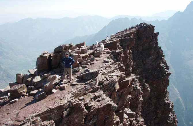 "Mark Obmascik stands atop North Maroon Peak. Obmascik was an out-of-shape suburban father, but he grew to have a new appreciation for Colorado's mountains, his life and his family after climbing all of the state's 14,000-foot peaks. Obmascik will be in Steamboat Springs at 6:30 p.m. Friday at Epilogue Book Co. to speak about and sign the book he wrote about his experience, ""Halfway to Heaven."""