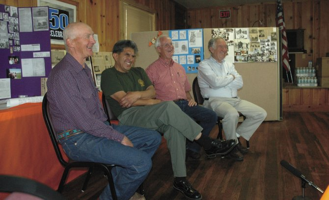 Hayden's former basketball stars reminisced merrily Saturday about the 1959 high school team. From left: Jerry Green, Bob Ruiz, Lyle Breshears and Larry Johnson discuss their team on camera at the American Legion hut in Hayden. The team lost to Sanford at state.