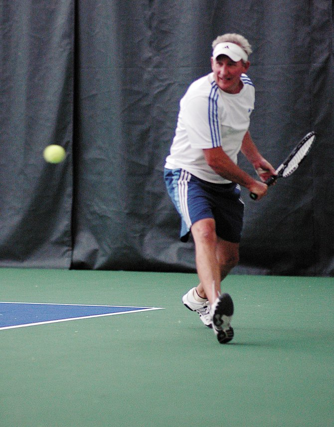 Steamboat Springs resident Ed Mooney looks to return a ball Sunday during the Intermountain Tennis Association&#39;s Senior Sectional Tennis Championships at The Tennis Center at Steamboat Springs.