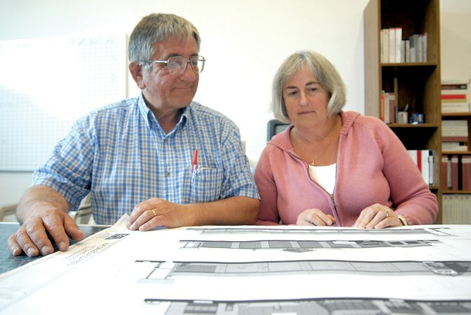 Lonnie, left, and Lorraine Kawcak look over sketch drawings of the new MJK Sales and Hardware site Tuesday. The Kawcak family has owned MJK since it opened in 1976, and the new project will be their second expansion.