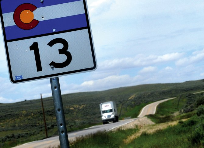 A truck rolls south on Colorado Highway 13 north of mile marker 113. The section of the highway between mile markers 111 and 123 is in need of major repairs, but the Colorado Department of Transportation said funding needed to pay for the project is not available.