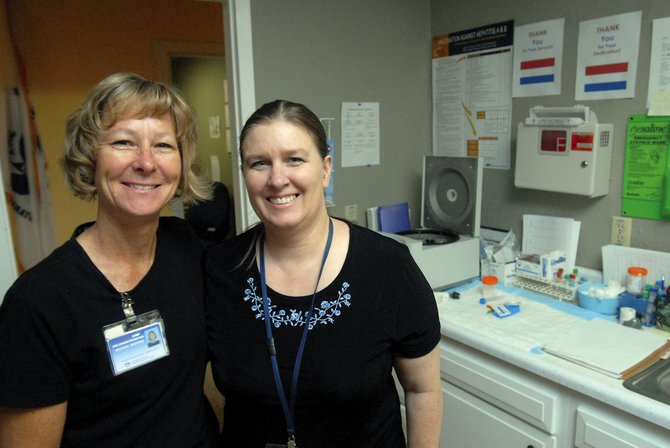 April Branstetter, left, and Gina Andujo are the two full-time nurses at the Craig VA Telehealth Outreach Clinic. The clinic relies on technology, which allows its patients, all of whom are military veterans, to interact with a physician 150 miles away in Grand Junction.