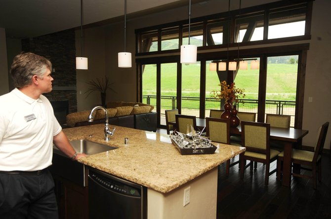 Todd Siefken, general manager of Trailhead Lodge, stands in the kitchen of one of the recently-completed units. Three of the 86 luxury units have closed, and another 60 are under contract.