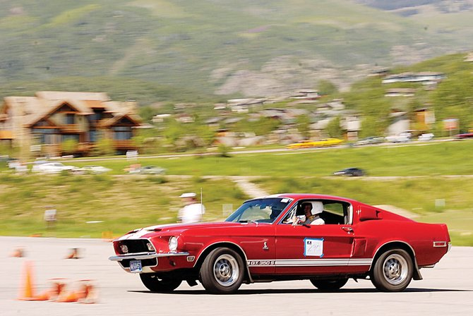 Gary Griffith, of Greenland, cuts a corner in his supercharged 1968 Shelby GT 350 at Meadows Parking Lot in Steamboat Springs. Griffith, who is in Steamboat for the annual Rocky Mountain Mustang Roundup, tore around the parking lot Friday in the autocross event.
