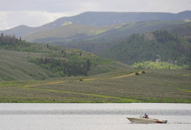 A boat cruises along Stagecoach Reservoir on Thursday afternoon. Boating under the influence laws became stricter in August 2008.