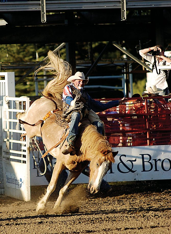 J.W. Winklepleck rides Friday in the bareback competition at the Steamboat Springs Pro Rodeo. Winklepleck rode in the event and served as the rodeo&#39;s clown. He will do so during four more weekends this summer.
