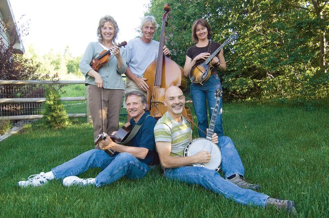 The bluegrass band Ragweed, which includes local musicians, clockwise from lower left, John Aviza, Bonnie Murray, Walt Seabert, Betsy Seabert and Von Wilson, is scheduled to play at 8:30 p.m. today at Ghost Ranch Saloon.